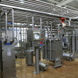 Stock Photo: Temperature control valves and pipes in dairy production factory
