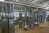 Temperature control valves and pipes in dairy production factory — Stock Photo
