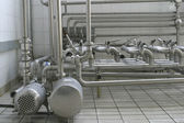 Pipes and valves in modern dairy — Stock Photo