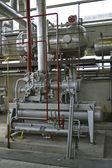 Průmyslové komponenty v továrně — Stock fotografie