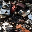 Old rusting cars in a junk yard — Stock Photo