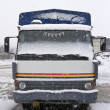An old truck parked in the snow — Stock Photo