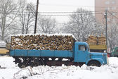 Old truck with firewood in the snow — Стоковое фото