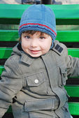 Boy on a green bench — Stock Photo