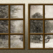 A winter view through a wood rustic window — Stock Photo #4464999