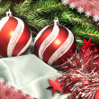 Christmas composition: balls, a tinsel and a fur-tree branch — Stock Photo #4277104