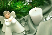 Christmas composition: Angel, a candle and a fir branch — Stock Photo