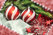 Christmas composition: balls, a tinsel and a fur-tree branch — Stock Photo