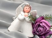 Christmas composition: Angel, a rose and a fir branch — Stockfoto