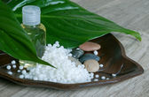 The essential oil with granulated cosmetic wax. — Stock Photo