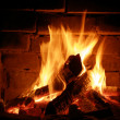 Fire in a fireplace — Stock Photo