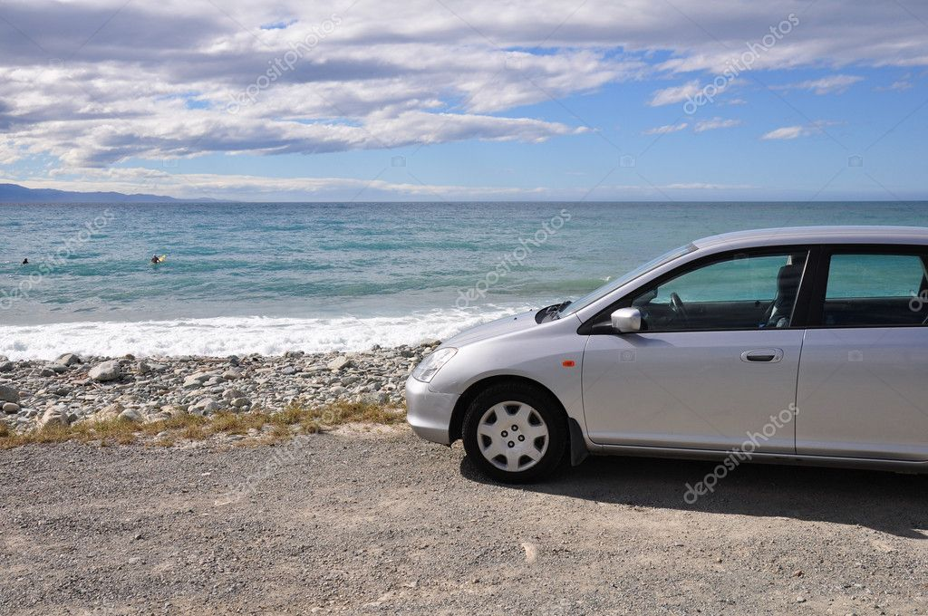 Car parked on the beach — Stock Photo #4911249