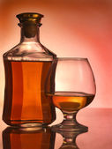 Cognac glass and bottle — Stock Photo