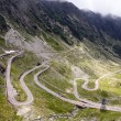 View with adventurous road and valley in Transfagarasan - Stock Photo