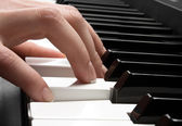 Piano and hand — Stock Photo