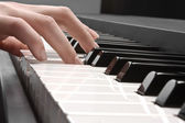 Piano and hand — Stock Photo