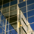 Stock Photo: Reflection on a skyscraper