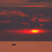 Boat on a sunset — Stock Photo