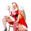 Two christmas girls offering gifts — Stock Photo