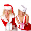 Stock Photo: Two christmas girls give a present