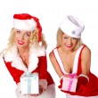 Royalty-Free Stock Photo: Two christmas girls give a present