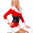 Cute girl in christmas costume is posing with a chair — Stock Photo