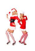 Two sexy girls in christmas costume flirt — Stock Photo