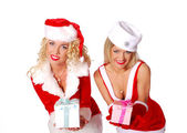 Two christmas girls give a present — Stock Photo