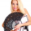 Nice lady in a rose corset holding a black fan — Stock Photo #4373697