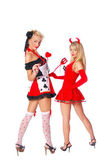 Two sexy girls in a party costumes. Devil and queen of hearts — Stock Photo