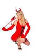 Mysterious sexy woman in a devil costume — Stock Photo