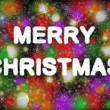 Merry Christmas hand writting text on colorful background with snowflakes - Stock Photo