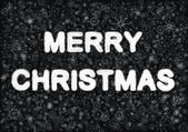 Merry Christmas hand writting on black background with snowflakes — Stock Photo