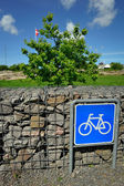 Bicycle sign with Danish flag — Stock Photo