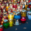 Royalty-Free Stock Photo: Colorful candles on cemetery