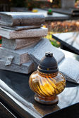 Candle on grave — Stock Photo