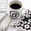 Coffee in white cup with at symbol — Stock Photo