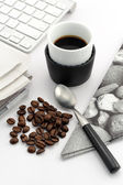 Espresso in small cup with coffee beans — Stock Photo