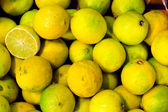 Yellow organic lemons on a counter — Stock Photo
