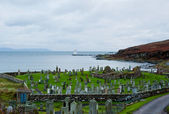Islay cemetery and lighthouse — Stock Photo