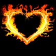 Blazing heart on the black background — Stock Photo #5247942