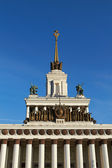 Soviet building with the star, columns and statues — Stock Photo