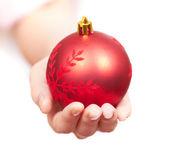 Girl gives a christmass gift — Stock Photo