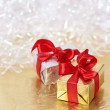 Gift boxes on reflective golden and shiny white background — Stock Photo