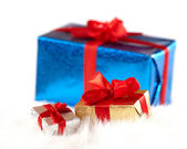 Two small gift boxes over the big one isolated on white — Stock Photo