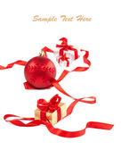Red ribbon, gift boxes and balls on white with copy space — Stock Photo