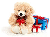 Teddy bear with presents isolated on white — Stock Photo