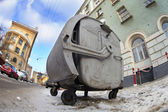 Old rusty trash can in a dirty city street — Stock Photo