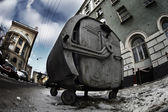 Scary old rusty trashcan in dark dirty city street — Stock Photo