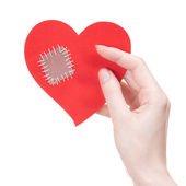 Girl holding Valentine's day card in a shape of broken heart — Stock Photo